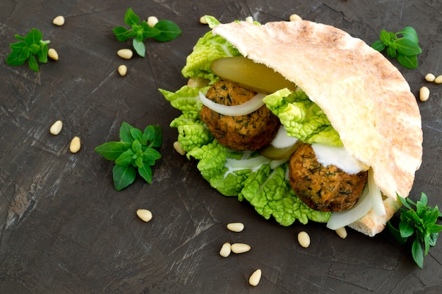 Arabic food. hummus and falafel on a gray background. Premium Photo