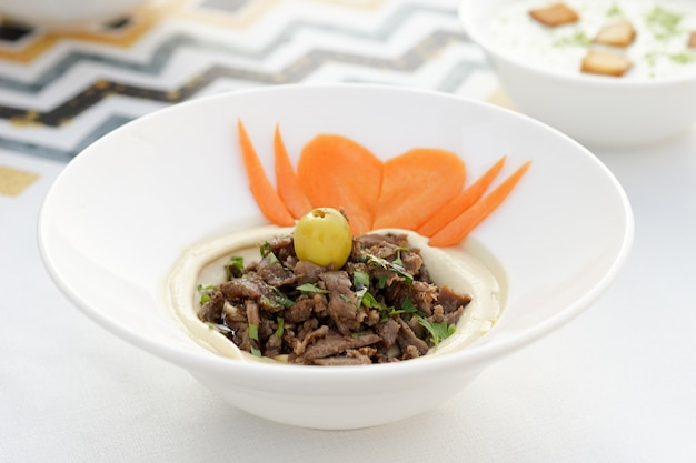 Arabic hummus shawarma, egyptian cuisine, middle eastern food, arabian mezza, arabian cuisine, arabian food Premium Photo