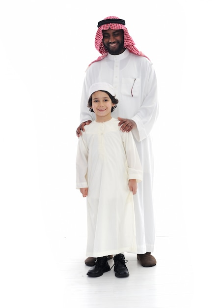 c89cec1fc Arabic muslim father and son standing together Photo | Premium Download