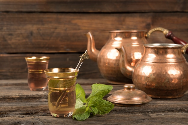Arabic tea in glasses with teapots Free Photo
