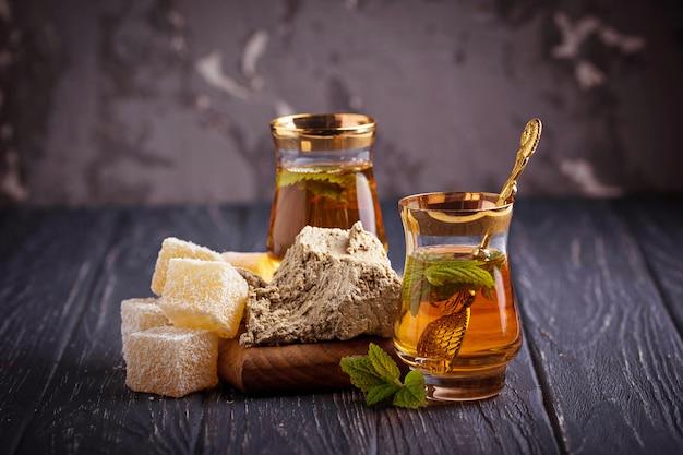 Arabic tea with turkish delight and halva Premium Photo