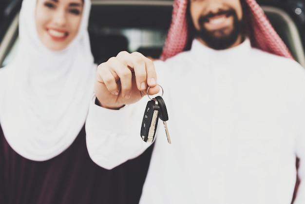 Arabs buy car man holds keys contract concept. Premium Photo