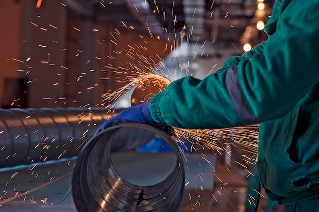 Arc welding of a steel in construction site Free Photo