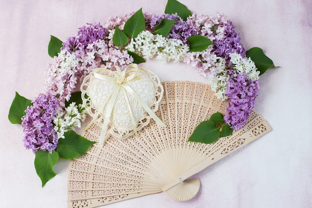 The arch of lilac, heart of lace and fan Premium Photo