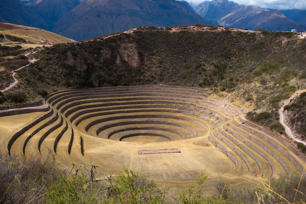 The archaeological site at moray, travel destination in cusco region and the sacred valley, peru. majestic concentric terraces, supposed inca's food farming laboratory. Premium Photo