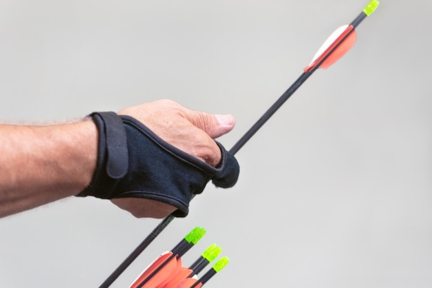 Archery. archer exercise with the bow. sport, recreation concept. sportsman is preparing the arrow for the shot. Premium Photo