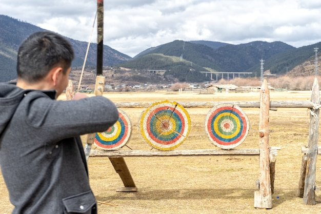 Archery it is mainly a competitive sport and recreational activity. focus on the targets. Premium Photo