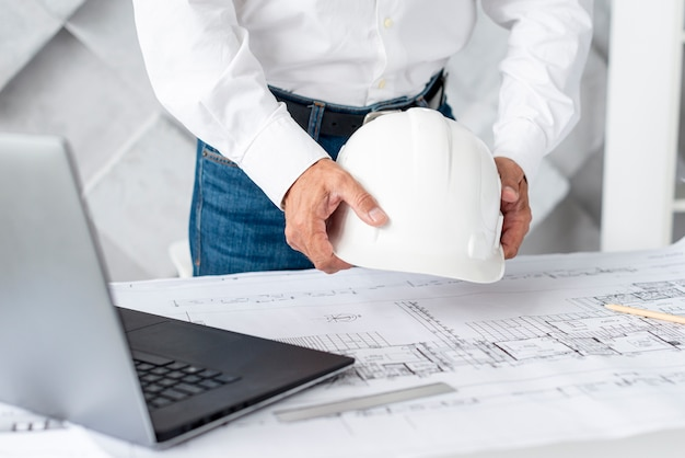 Architect arranging his desk with tools Free Photo