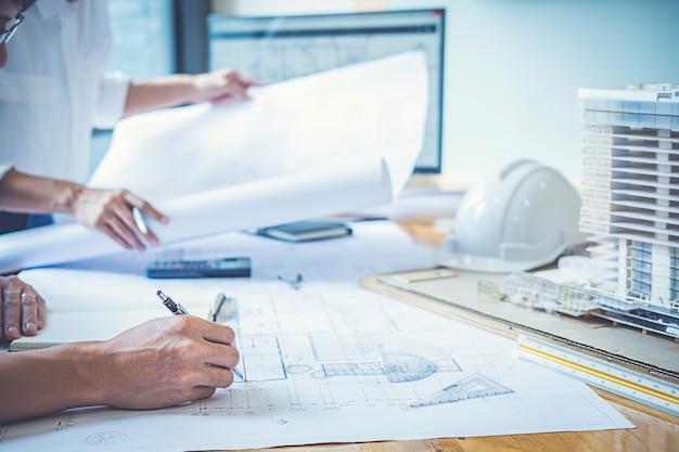 Architect engineer design working on blueprint planning concept architect engineer design working on blueprint planning concept construction concept premium photo malvernweather Images
