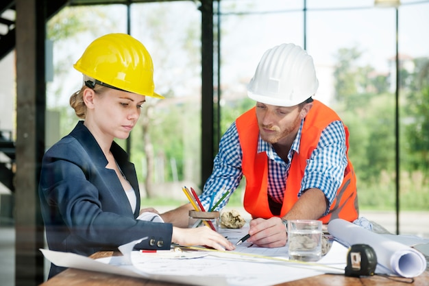 Architect engineer discussion brainstorming construction concept Free Photo