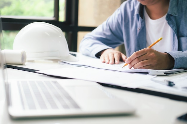 Architect or engineer working in office Premium Photo