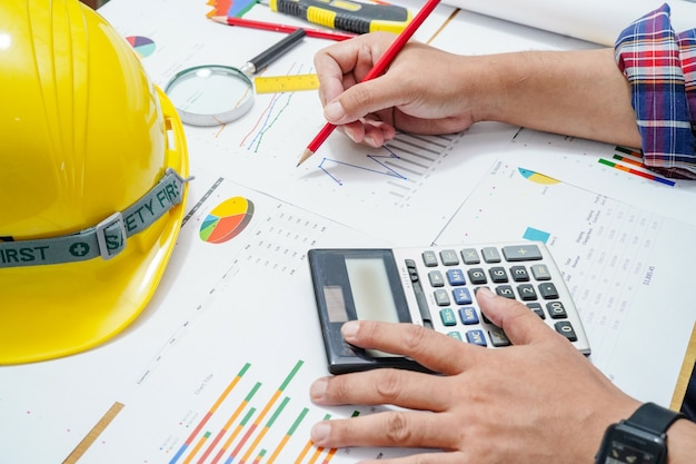 Architect or engineer working project accounting with graph in office. Premium Photo