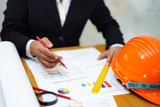 Architect or engineer working project with tools in office Premium Photo