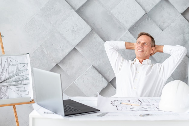 Architect relaxing after finishing project Free Photo