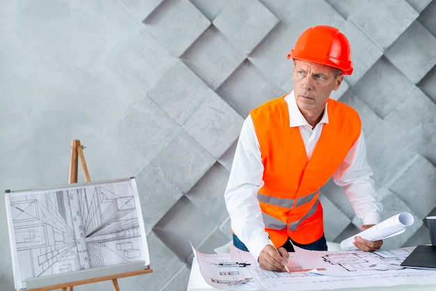 Architect in safety equipment Free Photo