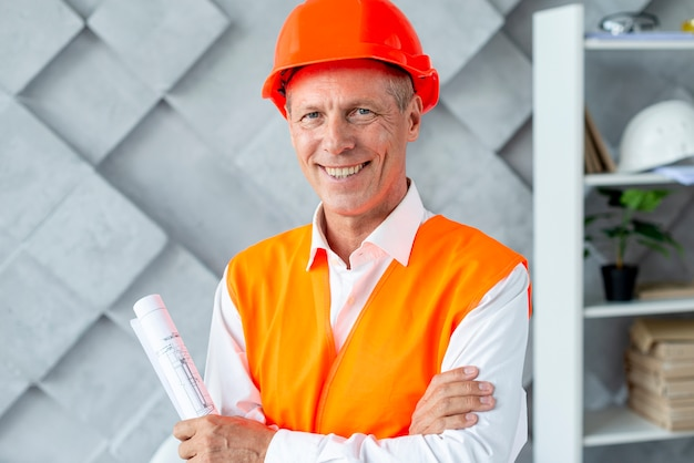 Architect smiling in safety equipment Free Photo