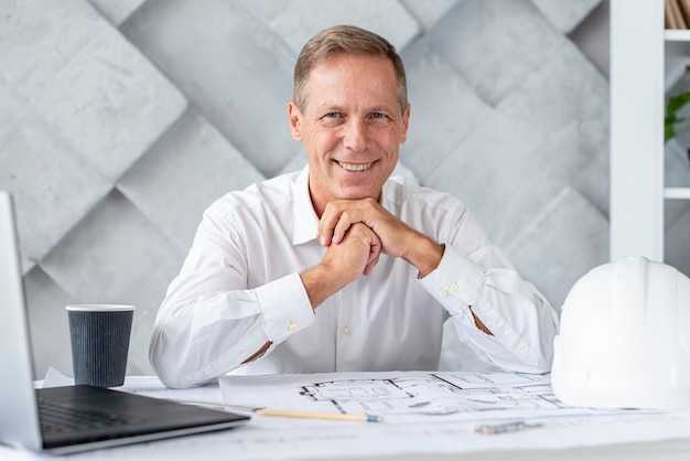 Architect smiling while looking at the camera Free Photo