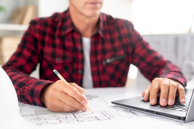 Architect using his laptop for project Free Photo