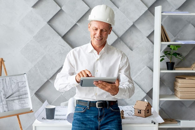Architect using tablet for inspiration Free Photo