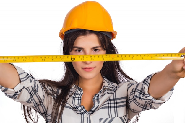 Architect woman holding a measuring tape. Free Photo