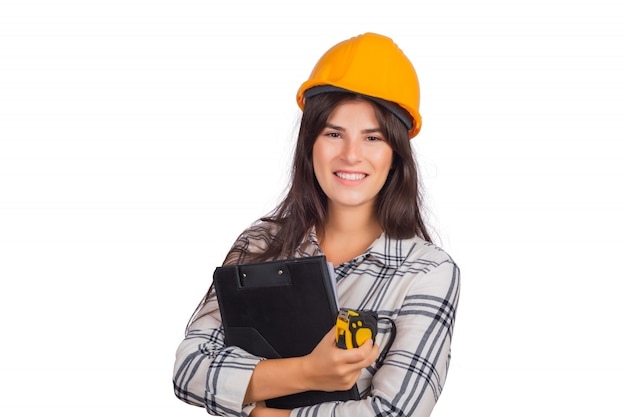 Architect woman wearing construction helmet and holding folders. Free Photo