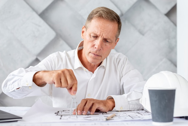 Architect working on his project Free Photo