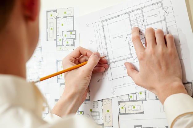 Architect working on house project Free Photo