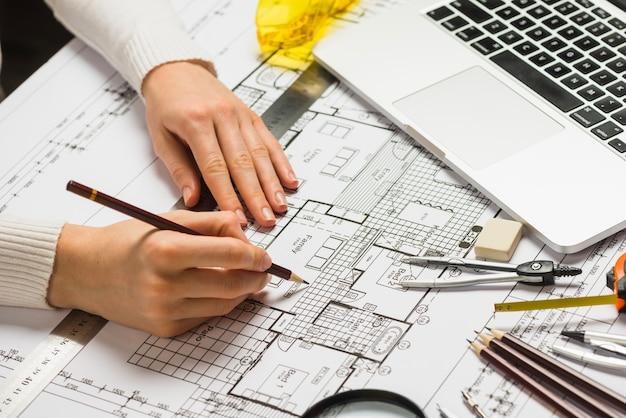 Architect working on blueprint photo free download architect working on blueprint free photo malvernweather Choice Image