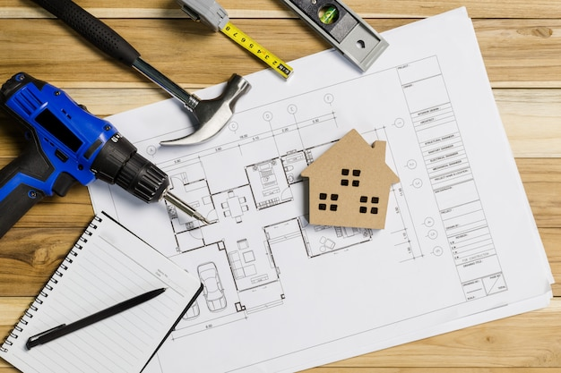 Architect workplace top view. architectural project, blueprints, blueprint rolls on table. construction. engineering tools. copy space Premium Photo
