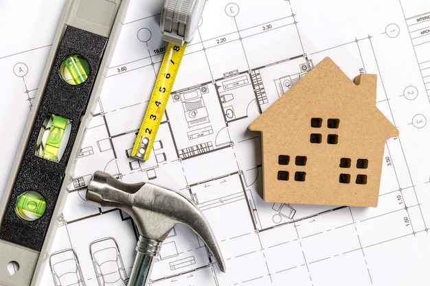 Architectural project, blueprints, blueprint rolls on table Premium Photo