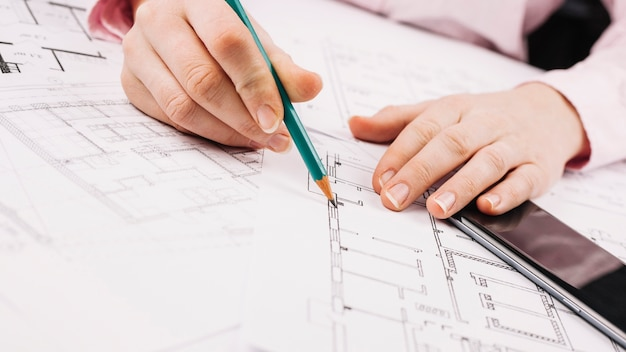 Architecture concept with building plan Free Photo