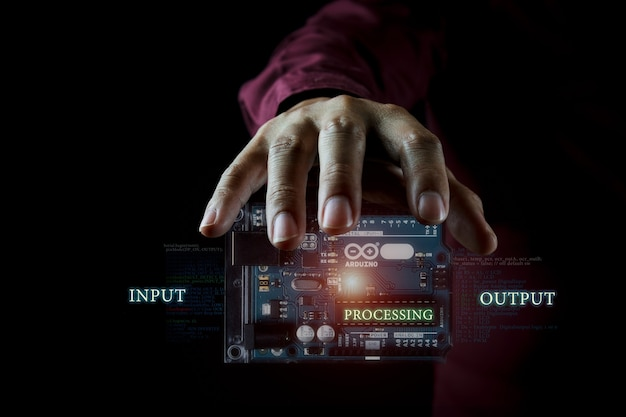 Arduino controller photo concept in the dark background and infographic details Premium Photo