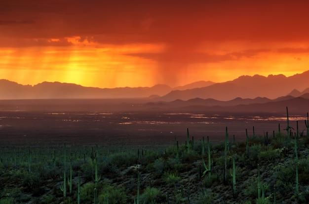 Arizona sunset over avra valley during summer monsoon season Premium Photo