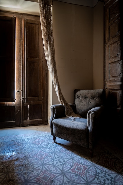 Armchair in a corner of the lounge in twilight Premium Photo