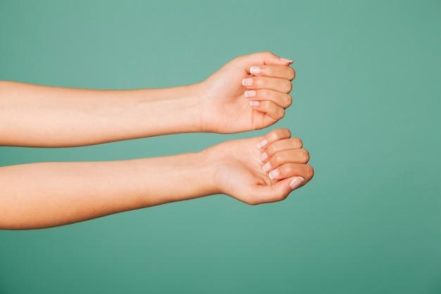 Arms showing nails Premium Photo