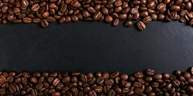 Aroma roasted coffee beans on rustic tabletop, brown banner background. Premium Photo