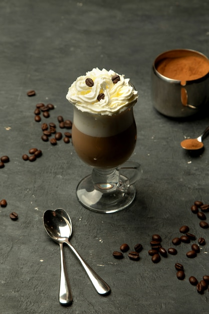 Aromatic coffee in a glass cup with whipped cream Free Photo