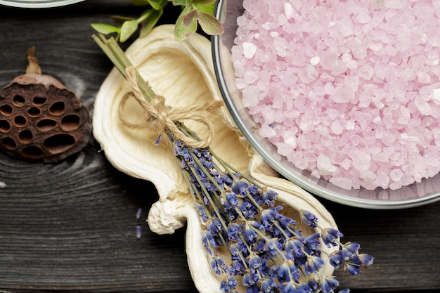 Aromatic composition of lavender, herbs, cosmetics and salt on a dark table top Premium Photo