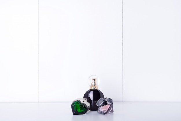 Aromatic perfume bottles on a shelf in the bathroom, copy space Premium Photo