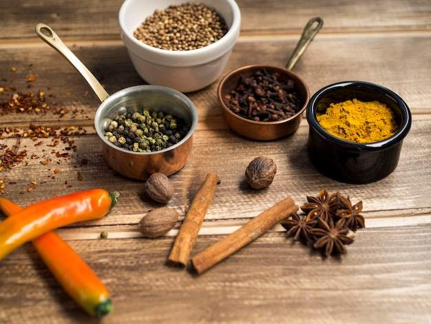 Aromatic spices near containes Free Photo