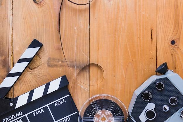 Arranged film stocks with clapperboard Premium Photo