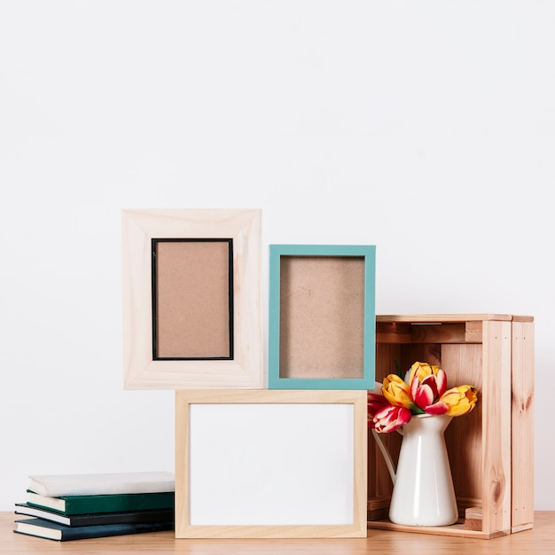 Arranged notepads with frames on table Free Photo