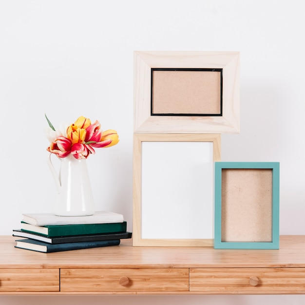 Arranged photo frames on table Free Photo