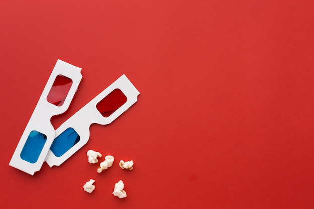 Arrangement of 3d glasses on red background with copy space Free Photo