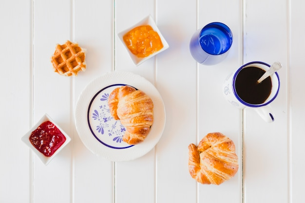 Arrangement of baked buns and coffee Free Photo