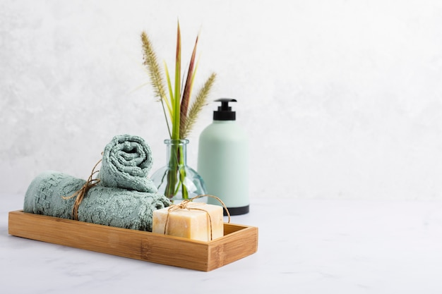 Arrangement for bath concept with soap and towel in box Free Photo