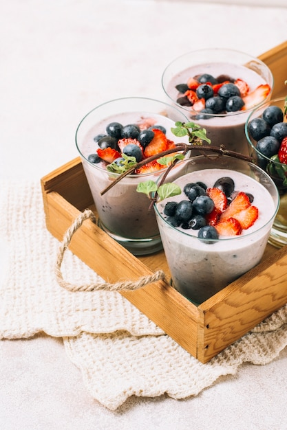Arrangement of blueberry and strawberry smoothies Free Photo