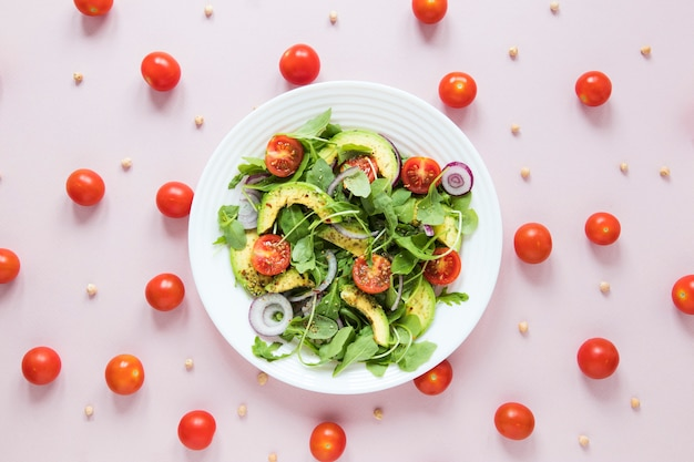 Arrangement of cherry tomatoes with bowl of salad Premium Photo