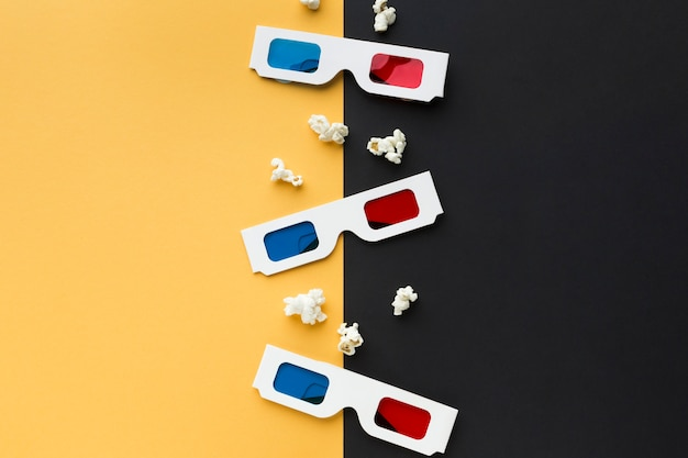Arrangement of cinema objects on bicolor background Free Photo
