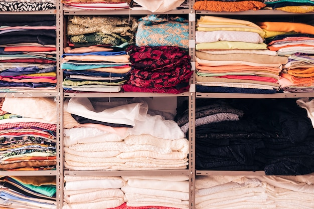 Arrangement of colorful fabric in the shelf Free Photo
